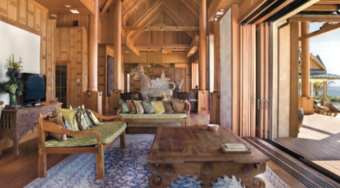 Nandana's main villa with its soaring 40′ ceilings houses the living areas, dining room, kitchen, bar and wine room.